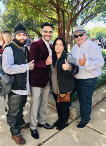 Terry Scholar with his family giving an Aggie thumbs up at his Texas A&M ring ceremony